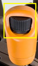 Thumbwheel located on the speed control lever